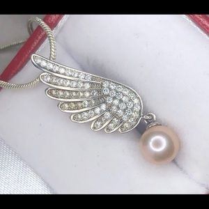 Angel wing pendant with czs